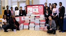 Students fill 155 shoe boxes with gifts for Operation Christmas Child.
